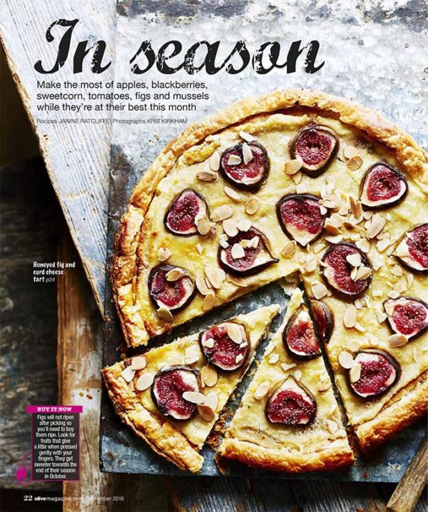 A fig and curd cheese tart decorate with figs and almonds, sliced and ready to serve
