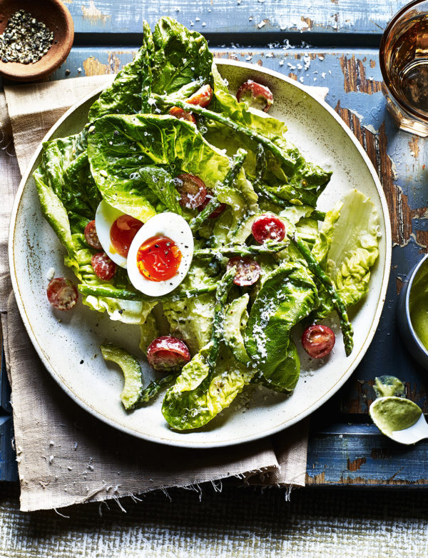 A crisp, refreshing salad dressed with gooey eggs, mozzarella and cherry tomatoes